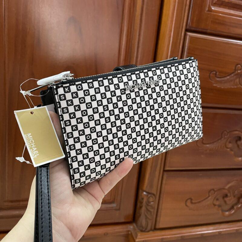 Túi ví cầm tay MK Michael Kors màu trắng đen